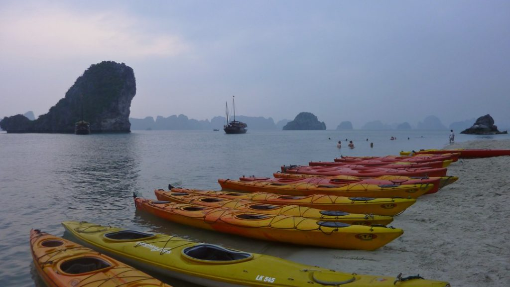 kayaking off a beach in Bai Long Bay