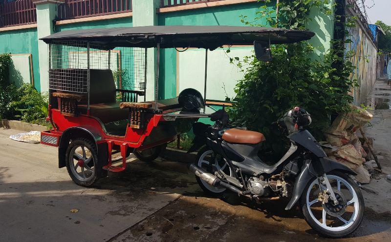 Red tuk tuk in the street in Cambodian capital
