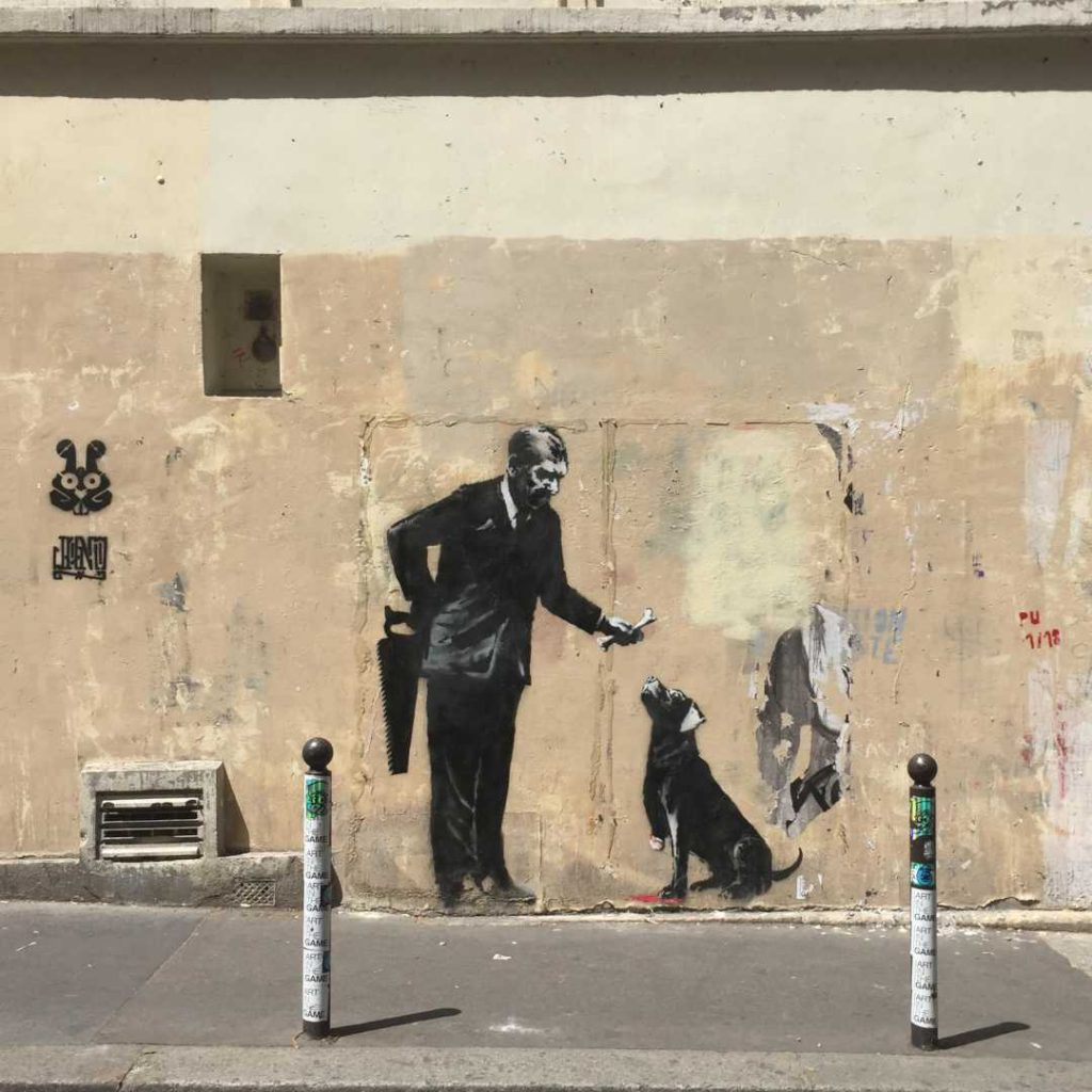 Banksy Paris Businessman and dog